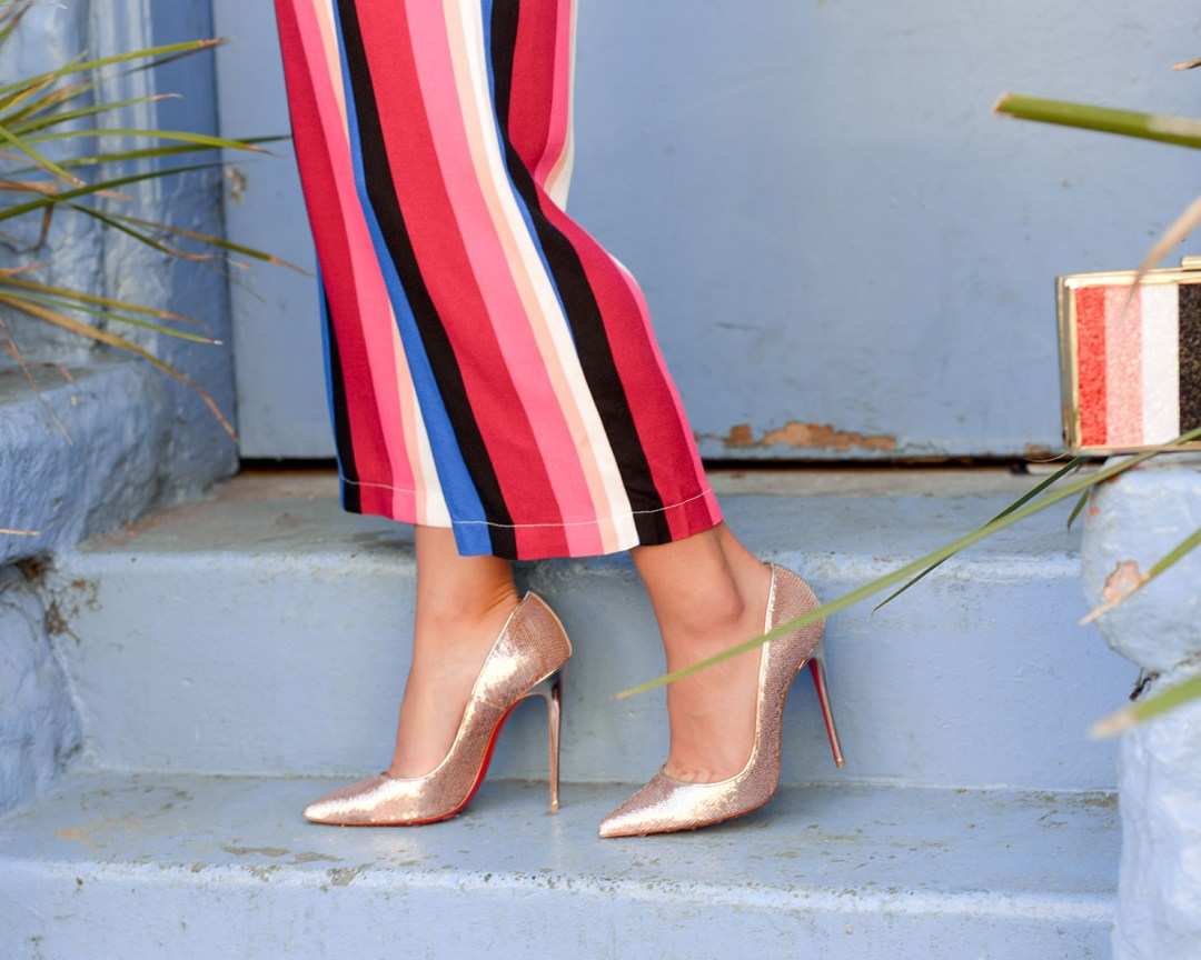 Lifestyle blogger Kelsey Kaplan of Kelsey Kaplan Fashion wearing Christian Louboutin So Kate pump and stripe pants
