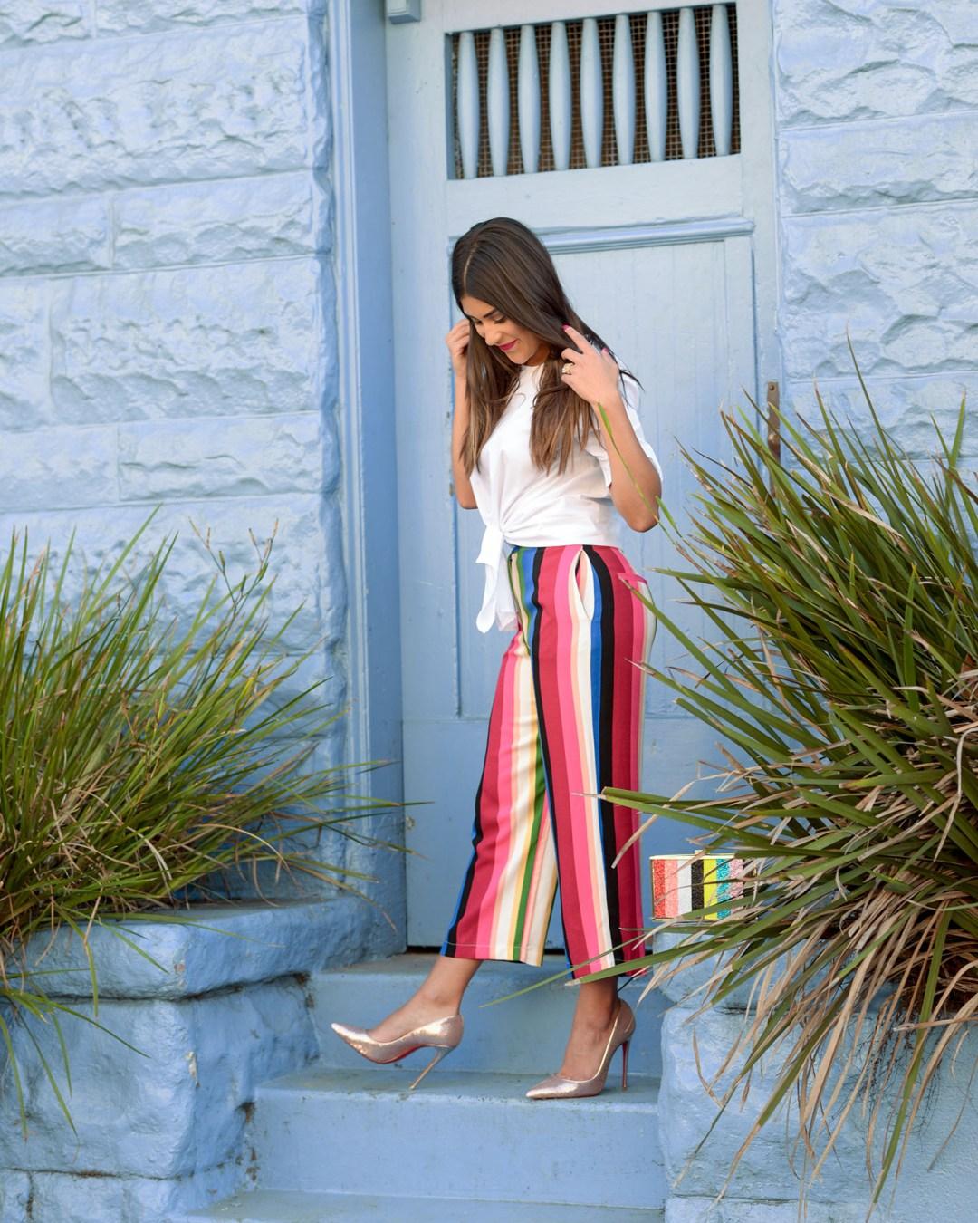 Lifestyle blogger Kelsey Kaplan of Kelsey Kaplan Fashion wearing sequin Louboutins and stripe pants