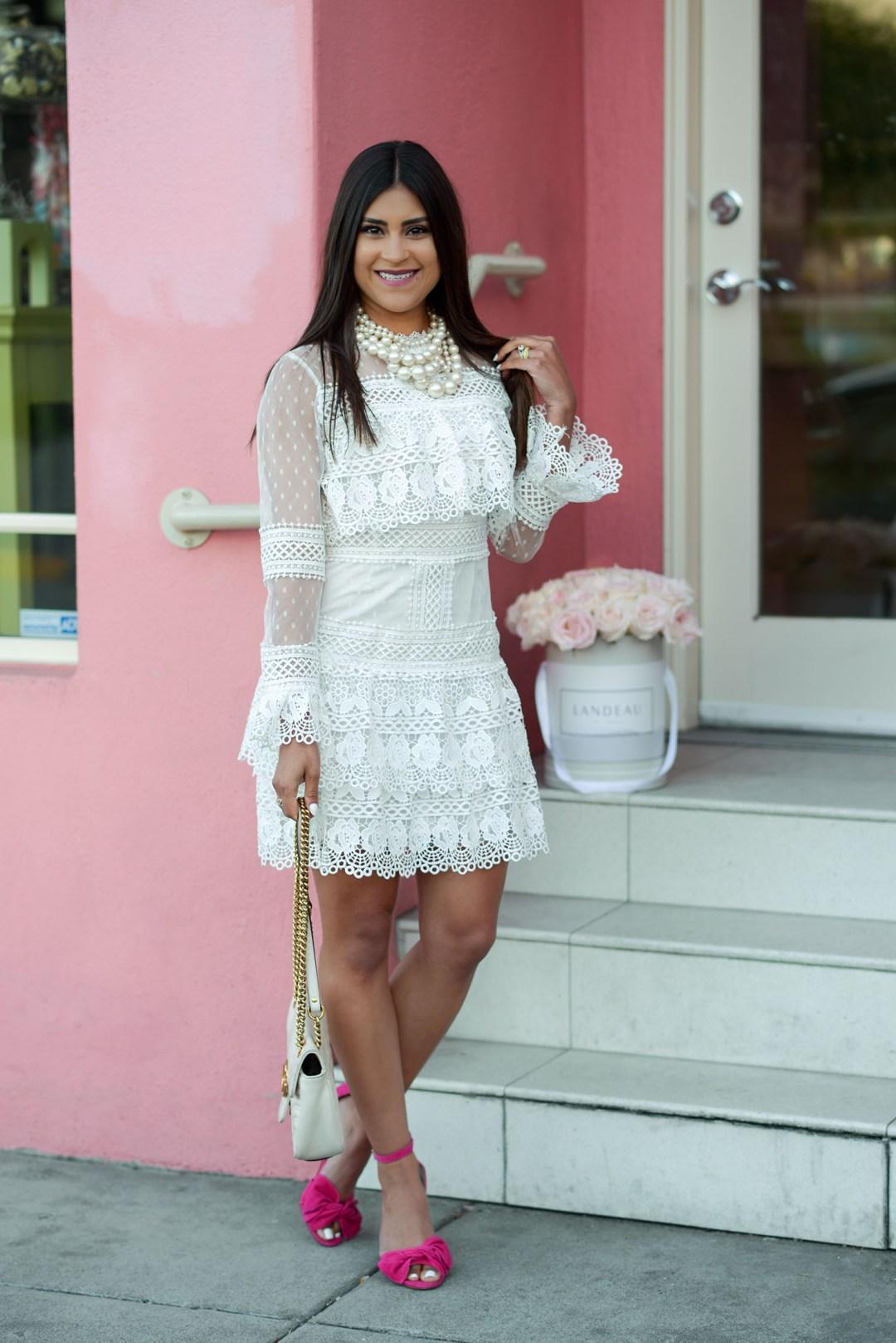 Kelsey Kaplan of Kelsey Kaplan Fashion wearing white crochet dress and white gucci purse