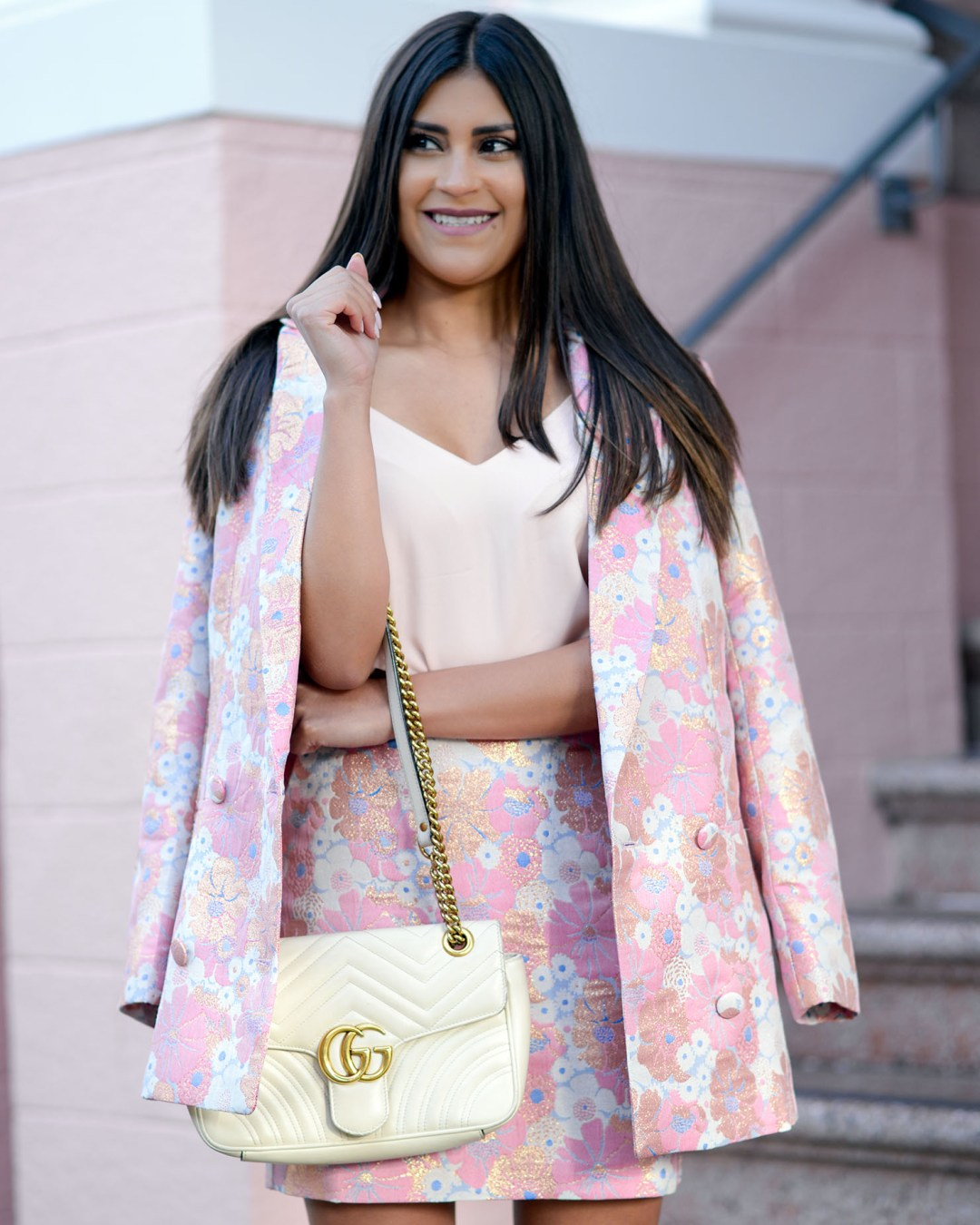 Lifestyle blogger Kelsey Kaplan of Kelsey Kaplan Fashion wearing pink power suit and white gucci purse