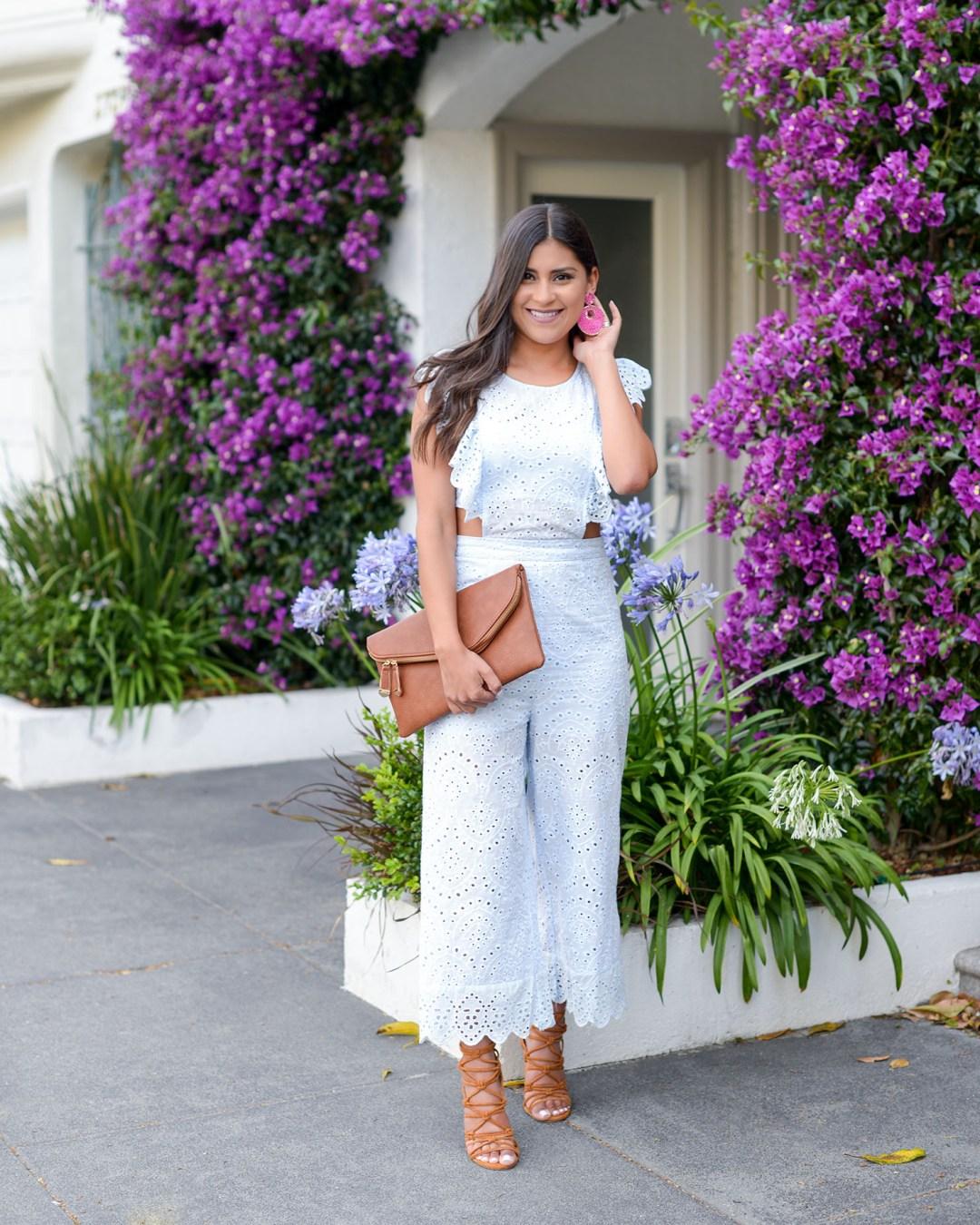 Lifestyle blogger Kelsey Kaplan of Kelsey Kaplan Fashion wearing eyelet jumpsuit from VICI