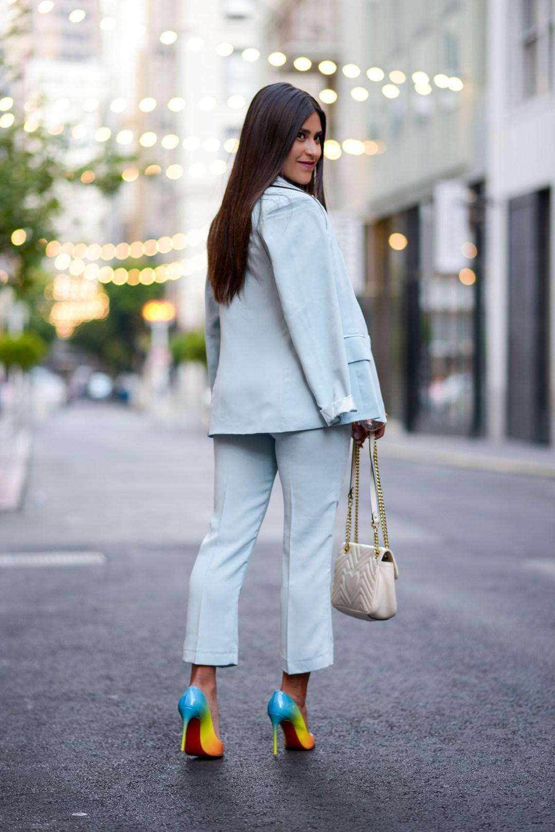 Lifestyle blogger Kelsey Kaplan of Kelsey Kaplan Fashion wearing blue suit and rainbow Christian Louboutin Pigalle Pumps