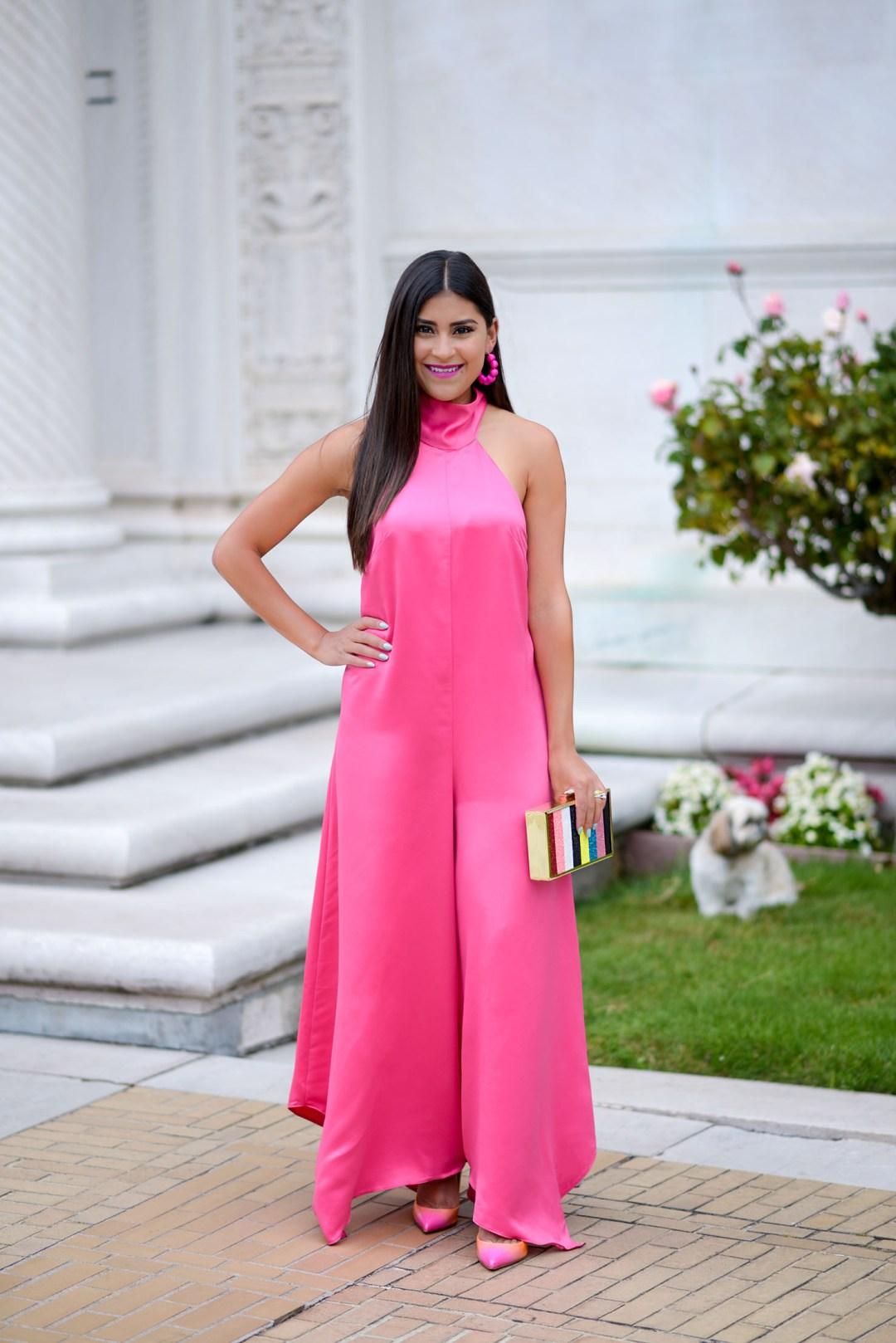 Lifestyle blogger Kelsey Kaplan of Kelsey Kaplan Fashion wearing pink jumpsuit and rainbow Louboutins in Las Vegas