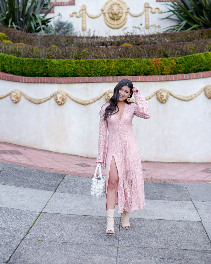 Lifestyle blogger Kelsey Kaplan of Kelsey Kaplan Fashion wearing pearl beaded purse and lace slit dress