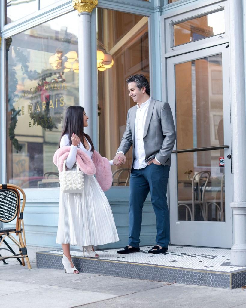 Lifestyle blogger Kelsey Kaplan of Kelsey Kaplan fashion wearing silver pleated skirt at Le Marais Bakery San Francisco