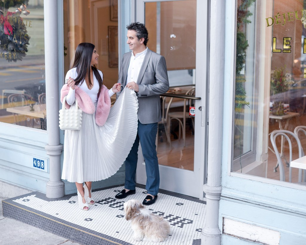Lifestyle blogger Kelsey Kaplan of Kelsey Kaplan fashion wearing silver pleated skirt at Le Marais Bakery San Francisco