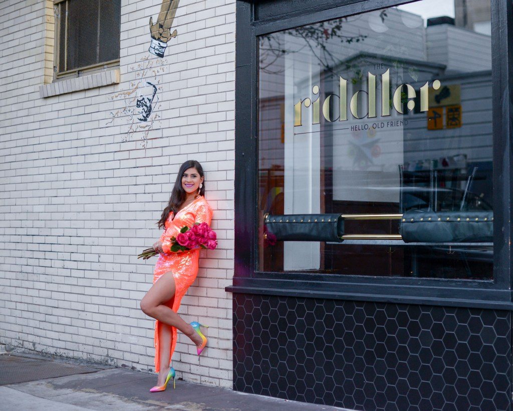 lifestyle blogger Kelsey Kaplan of Kelsey Kaplan Fashion wearing orange sequin dress and rainbow louboutin shoes.