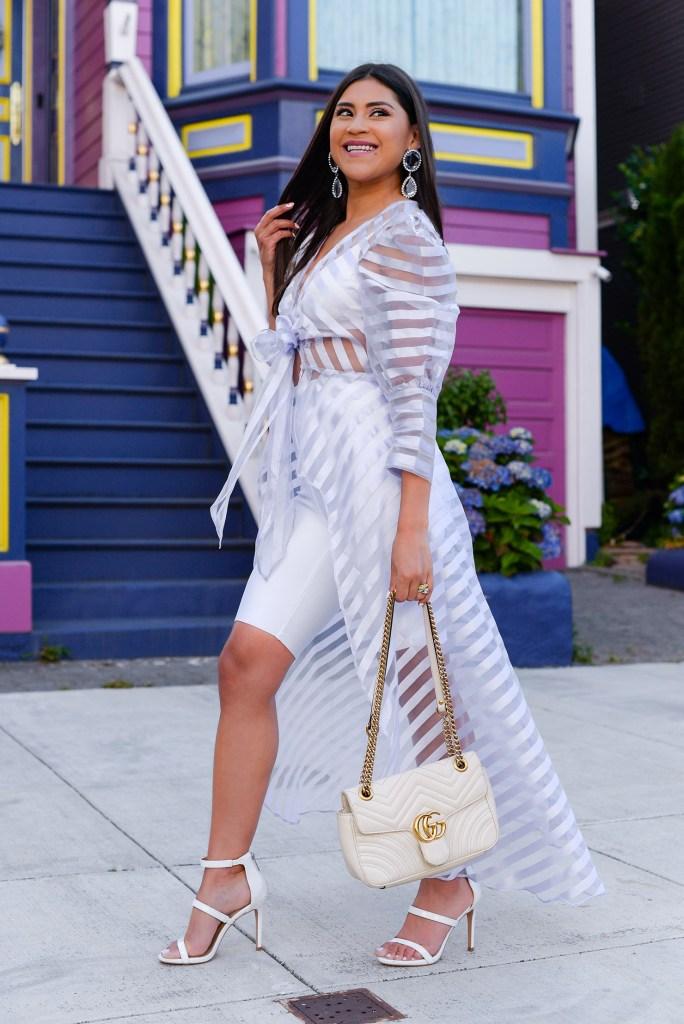 Lifestyle blogger Kelsey Kaplan of Kelsey Kaplan Fashion wearing white biker shorts and lavender blouse.