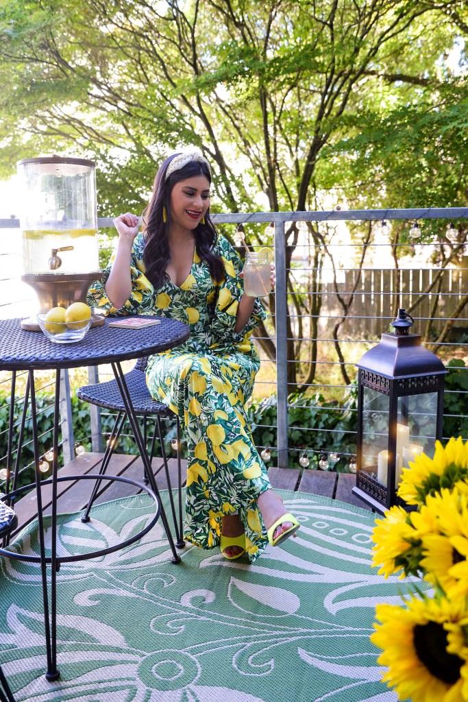 Lifestyle blogger Kelsey Kaplan of Kelsey Kaplan Fashion wearing lemon print dress.