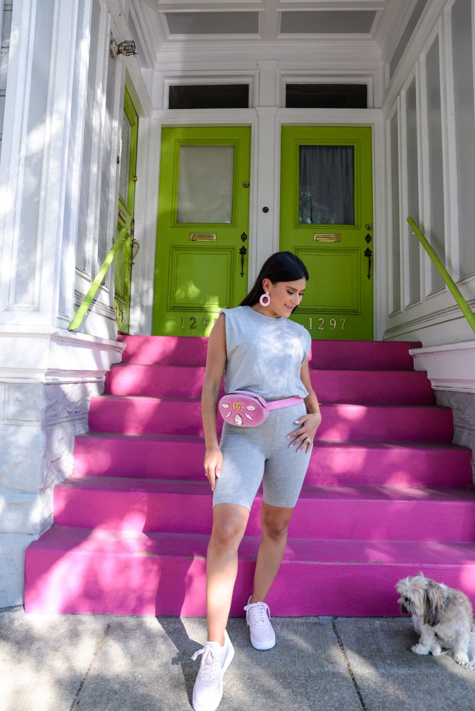Lifestyle blogger Kelsey Kaplan in unitard and pink Gucci belt bag.