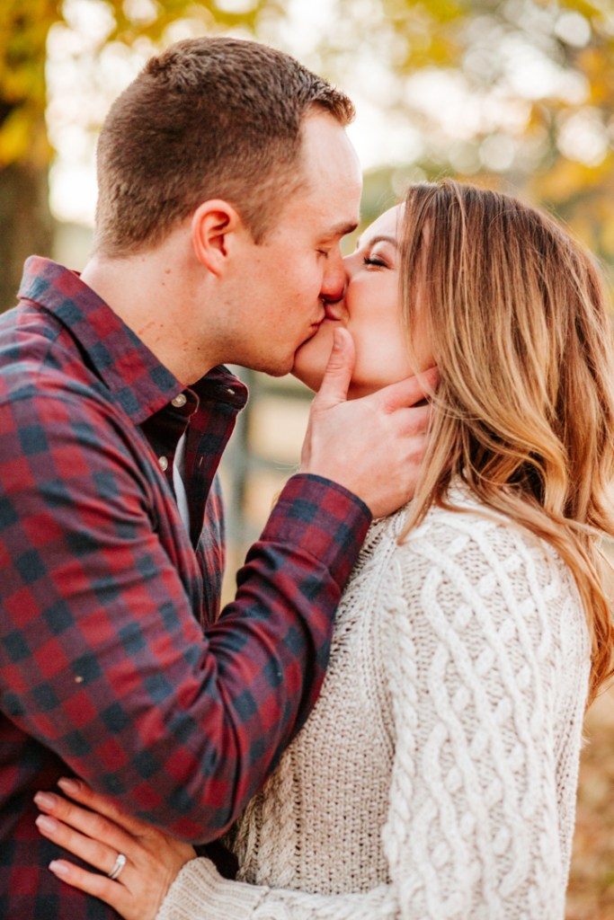 couple kissing during engagement session in knoxville tennessee