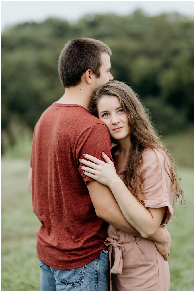 woman hugging man during outdoor engagements