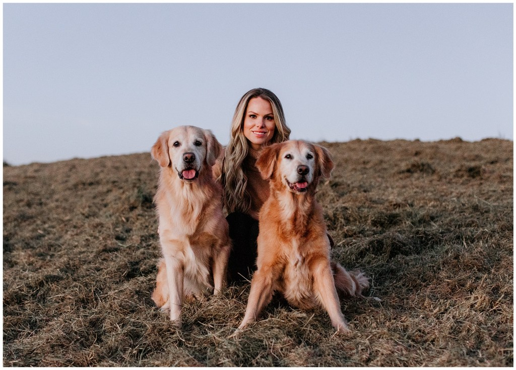 woman posing with golden retrievers in tennessee field