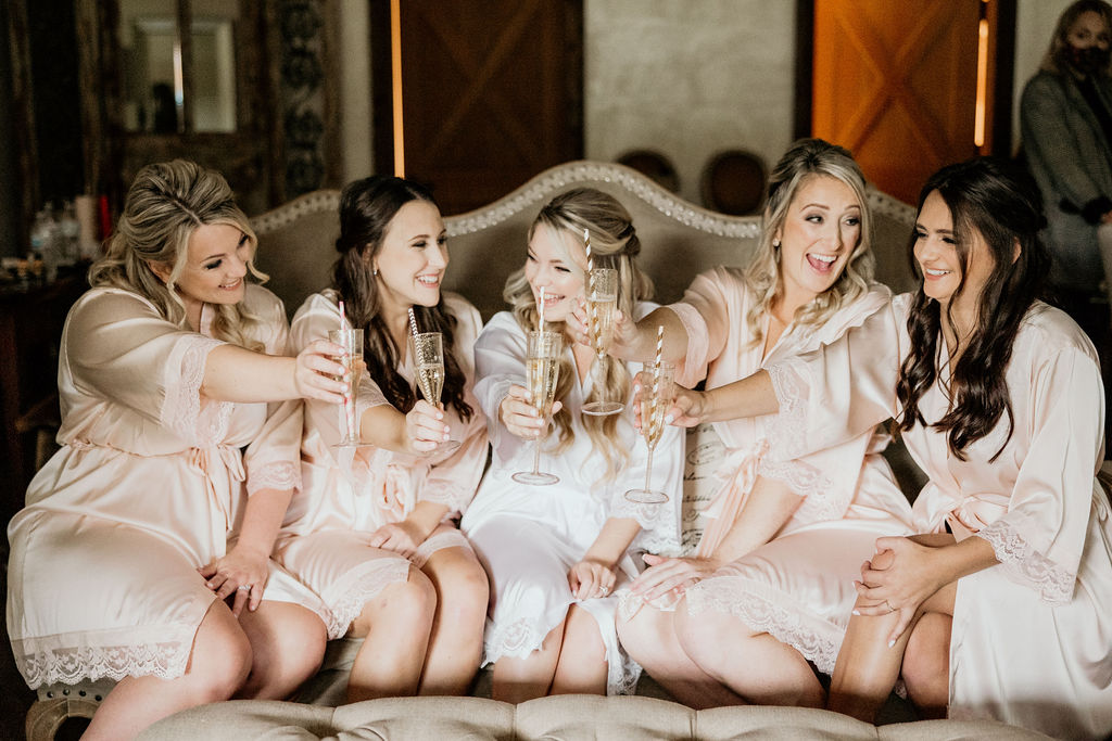 bride and bridesmaids celebrating wedding dayq
