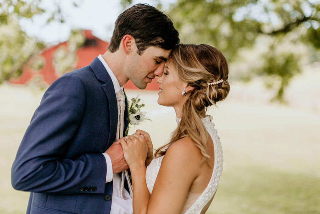 man and woman kissing during reception in tennessee wedding after using wedding day timeline