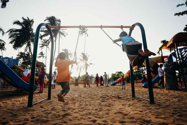 children playing on swing