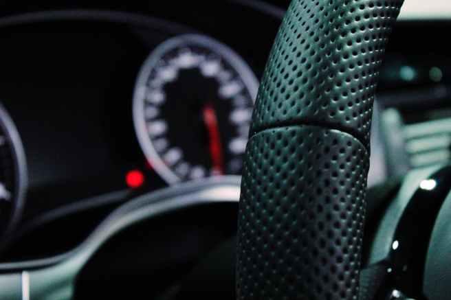 shallow depth of field photo of steering wheel