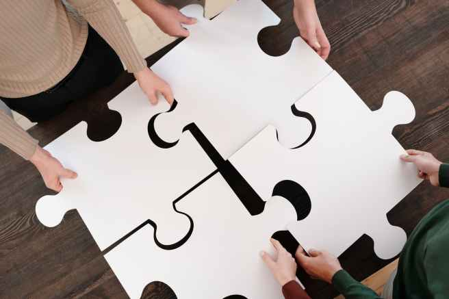person holding white puzzle piece
