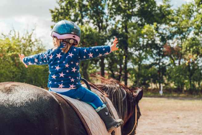 girl riding black horse
