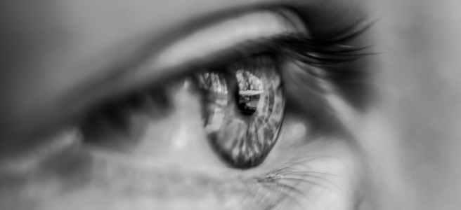 grayscale macro photography of person s eye