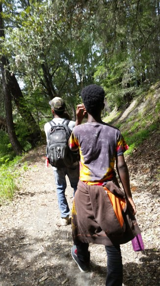 My brother carrying his youngest son on a hike at Squaw Lake and Young Lion.