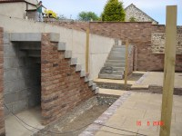 Concrete retaining wall and stairs | Kemp Developments