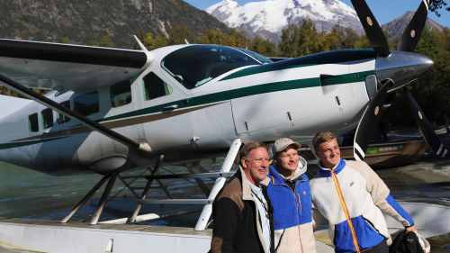 Nilsen family standing next to float plane during the Kustatan fly-in bear viewing adventure