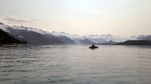 Jet Ski Adventures - a Jet Ski is floating in Blackstone Bay admiring the panoramic view of glaciers