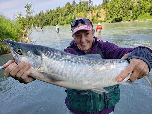 Kenai Riverside Resort customer holding a big Kenai River Sockeye