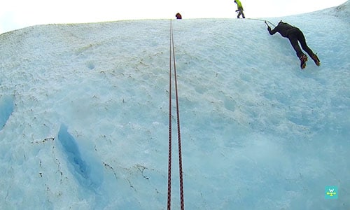 Climbing out of a glacier crevasse on our Exit Glacier Hiking & Climbing Adventure
