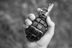 Hand holding bomb