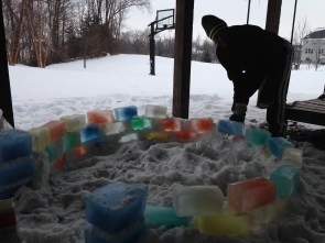 About 3 rows in we couldn't get the blocks to stick... Then Ben figured out we could use slush as the mortar. Saved the whole project! And made our hands wet and frozen.