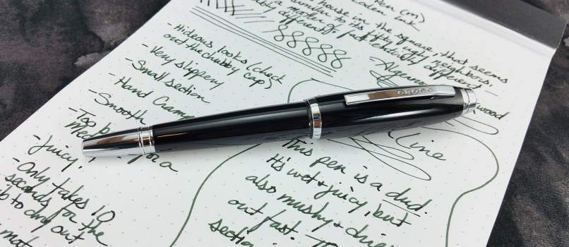The Cross Dubai Fountain Pen, capped and laying on top of the writing sample