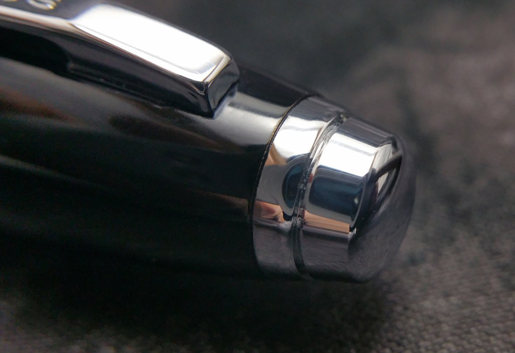 Close-up shot of the Cross Dubai Fountain Pen Finial, which is a tiered, chrome button shape