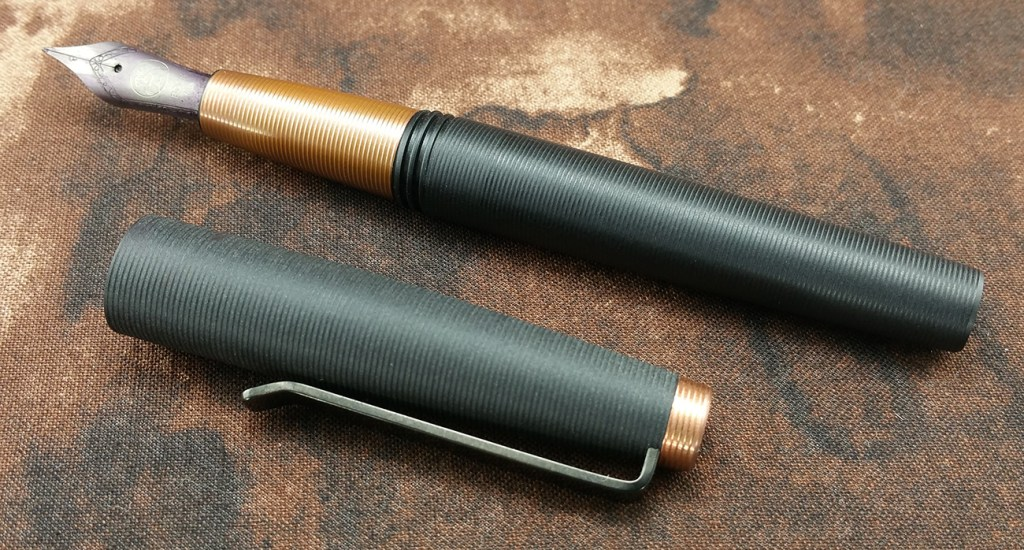 Tactile Turn Gist Fountain Pen Uncapped, with the pen and cap laying down along side each other