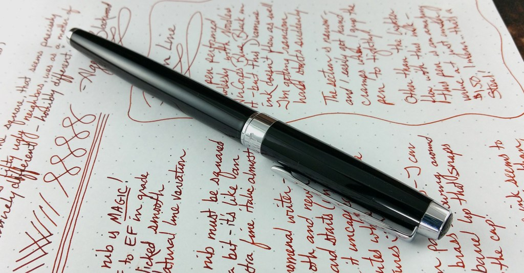 The Jinhao 3005 Fountain Pen, capped and laying down on top of the writing sample