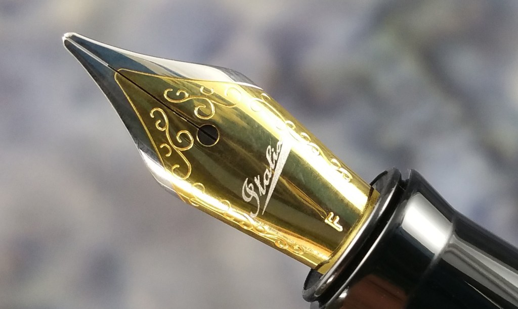 Close up shot of the Italix Parson's Essential Fountain Pen two-tone, stainless steel, #5 nib (Fine Cursive Italic)