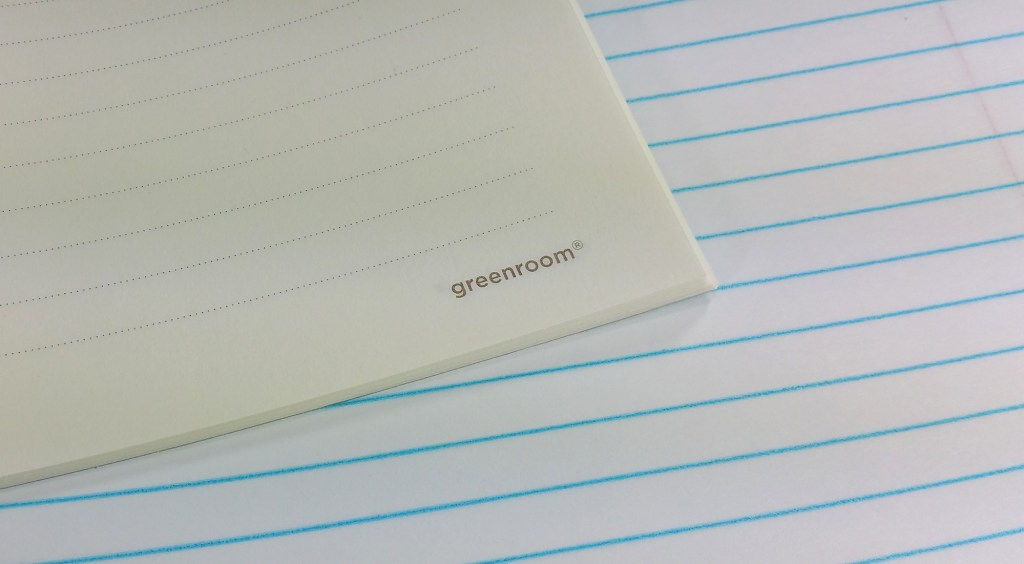 A comparison of the Greenroom Recycled Notebook Paper against bright white composition paper