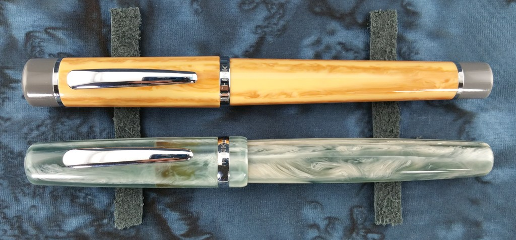 Think Couture Fountain Pens (Vacation and Violino) Featured Image, both pens capped and laying side-by-side