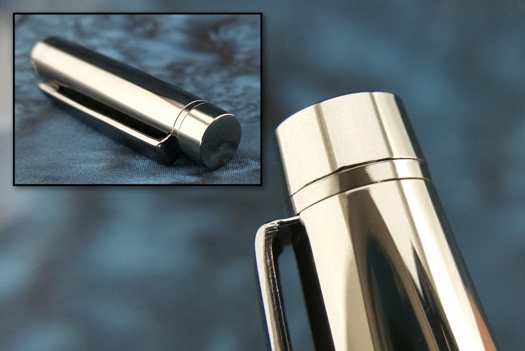 The Yiren 856 Fountain Pen Finial, the main image shows a close-up view from the side, and the inset image shows it from an angle, displaying it's flat top surface