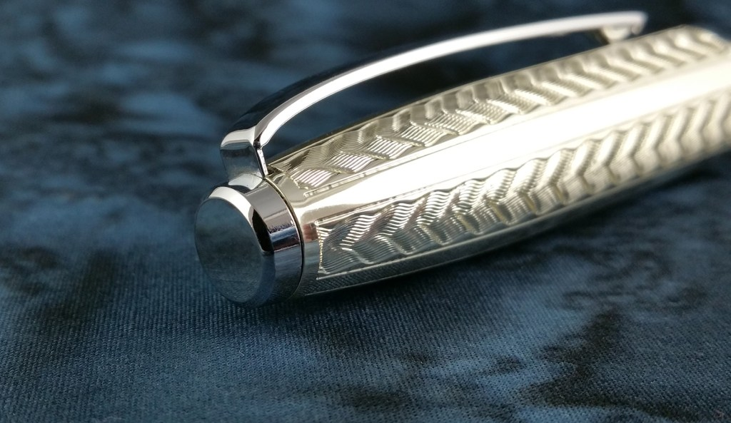 Close shot of the Yongsheng 088 Fountain Pen finial; also shows clip attachment