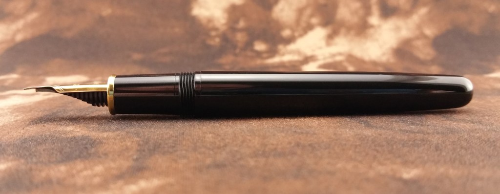 The Platinum 3776 Balance Maestro Fountain Pen laying down, without its cap and showing its nib from the side