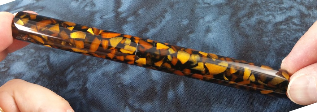 A picture of the Newton Pens Eastman Fountain Pen in Orange Flake Acrylic, capped