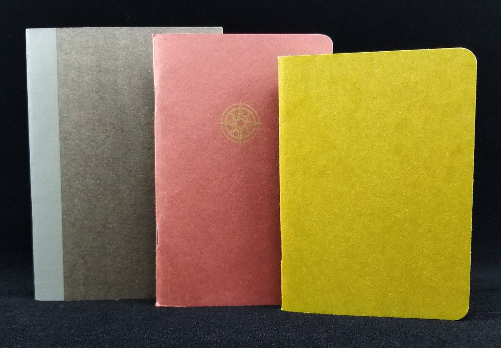 The next three notebooks I have to review. From the left: Muji Grid A6, Rosetta Notes, Scout Books.