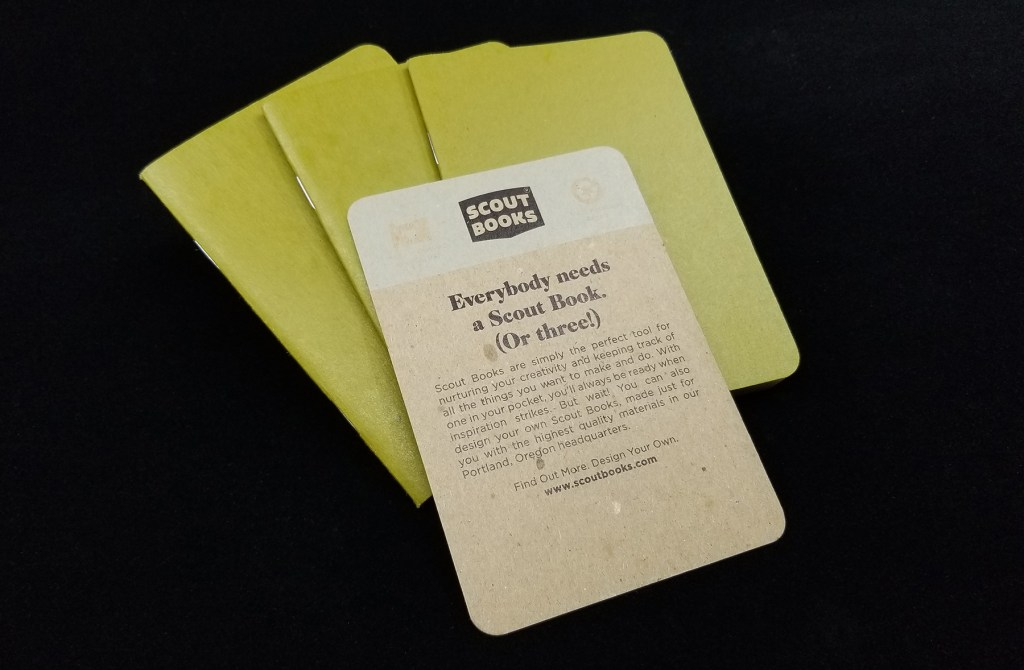 An image of the three Scout Books pocket notebooks and brand card from one three-pack of notebooks