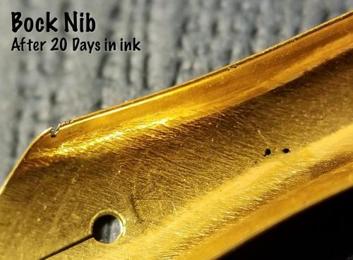 Underside view of the Bock nib after 20 days in the Aristotle Iron Gall ink. This view shows the final state of the holes corroded straight through the nib and the huge pit on the shoulder of the nib.