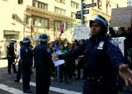 NYPD officers hold back a crowd of Occupy Wall Street protesters Monday, Sept. 19, 2011. (Photo/Kendra Yost)