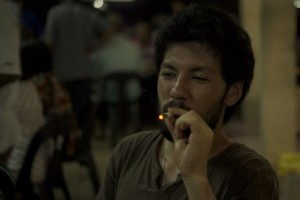 Having a cigarette which I got from a local man in Malaysia