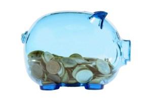 Blue transparent piggy bank with euro coins.