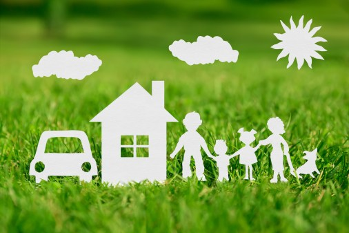 Paper cut of family with house and car